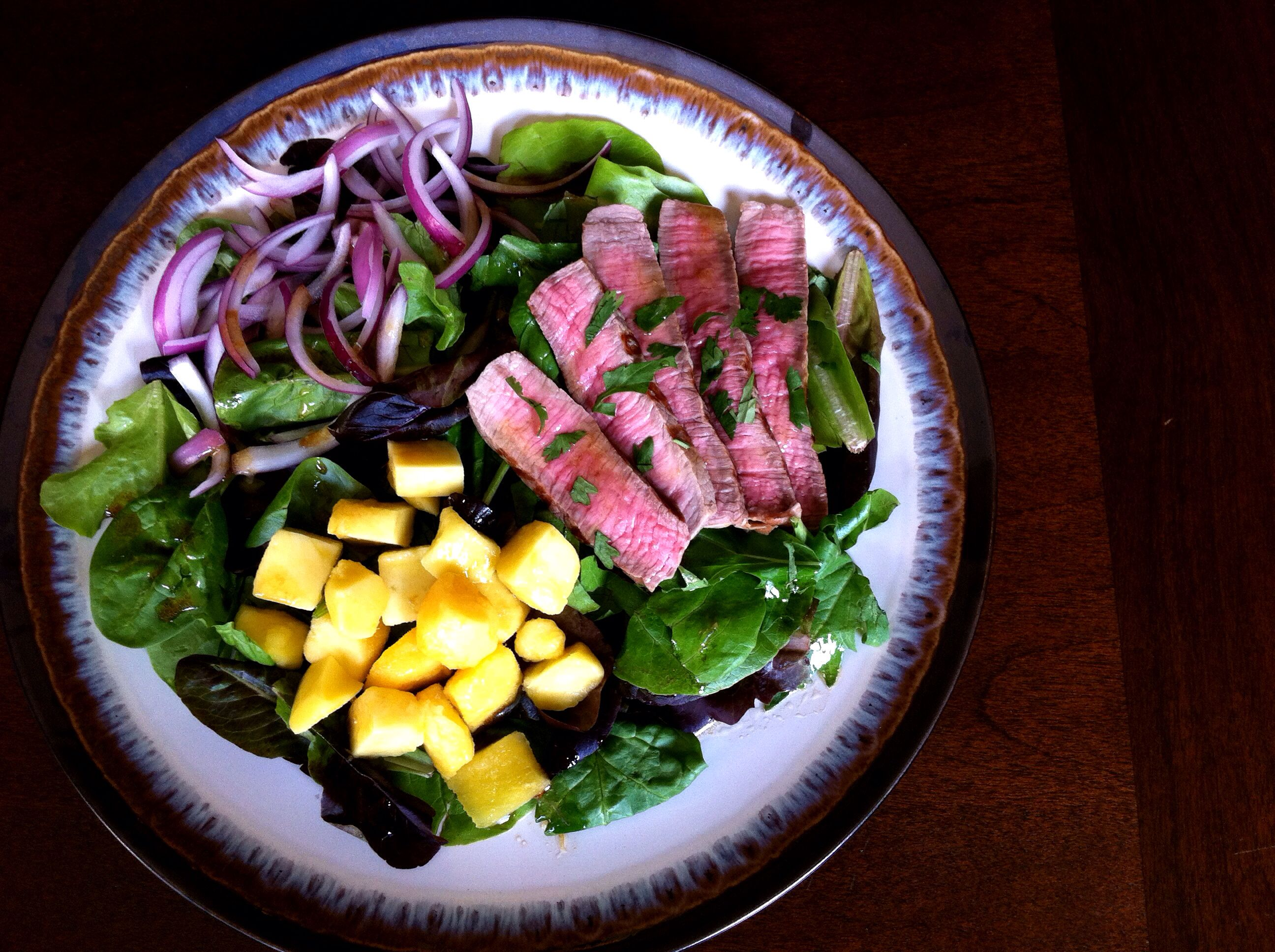 Barbequed Steak Salad with Mango and Red Onion